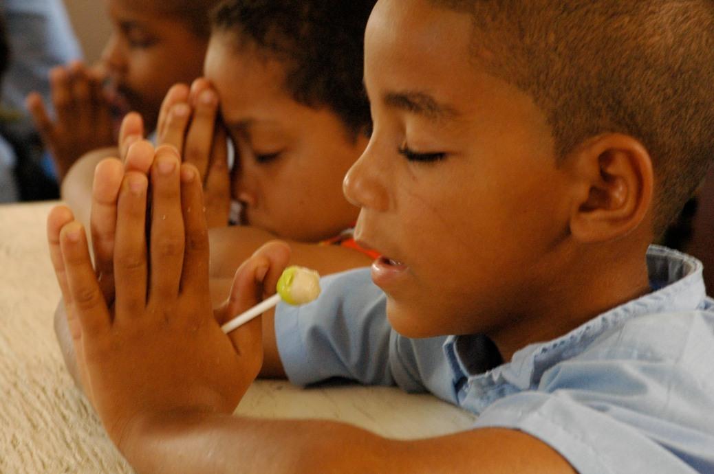 Children praying during a mission trip